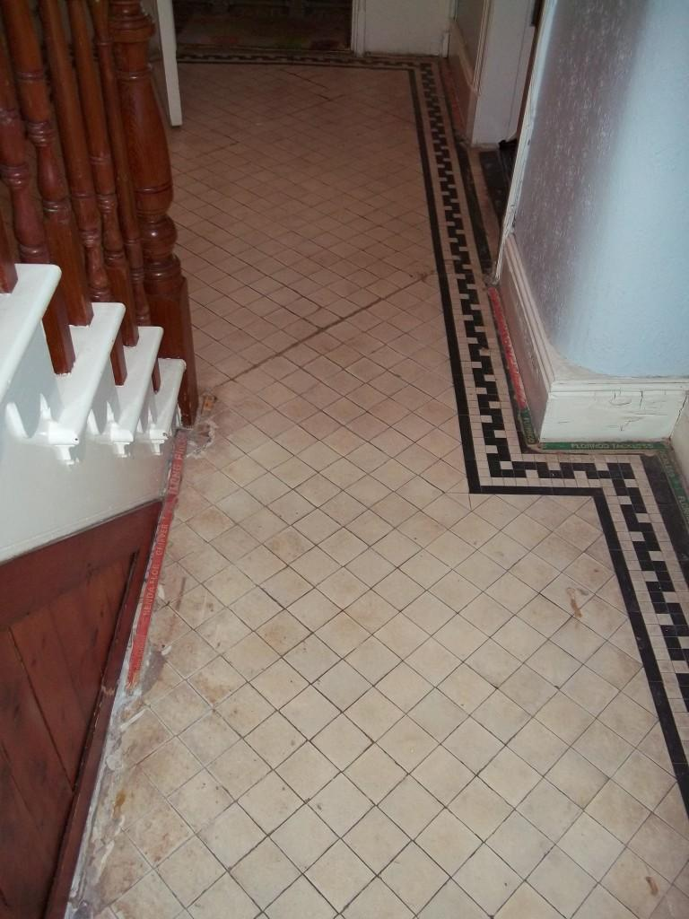 Old victorian tiled floor before cleaning in Newquay